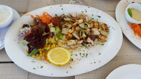 Grilled calamari at one of the chiringuitas on Playa Es Caballet